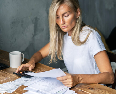 woman looking at finances